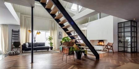 Transformatie sporthal tot woonruimte - eindresultaat - moderne en sfeervolle afwerking - Eindhoven